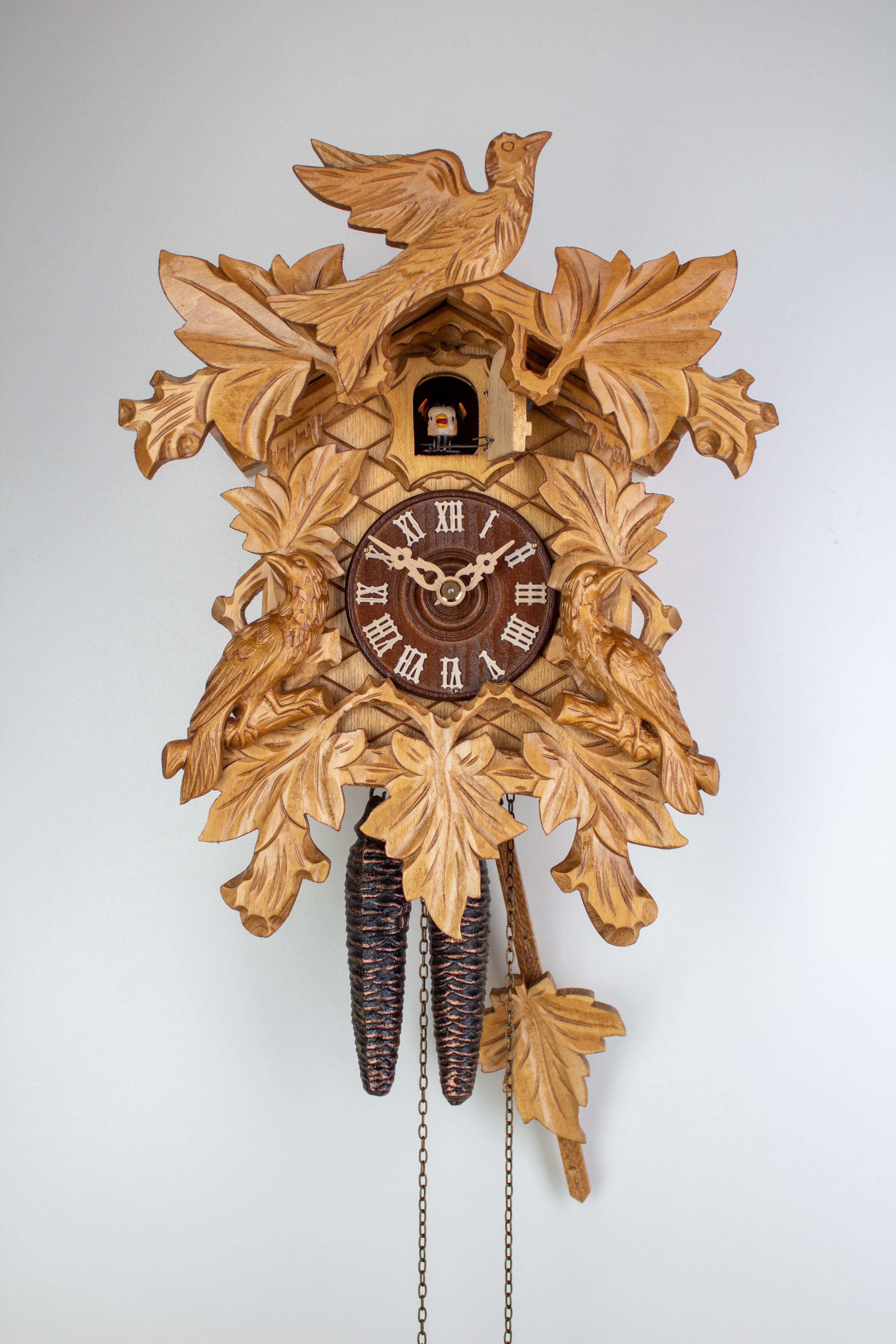 1 Day Cuckoo Clock vine leaves with cuckoo family and bird